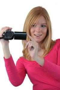 Woman holding compact video camera