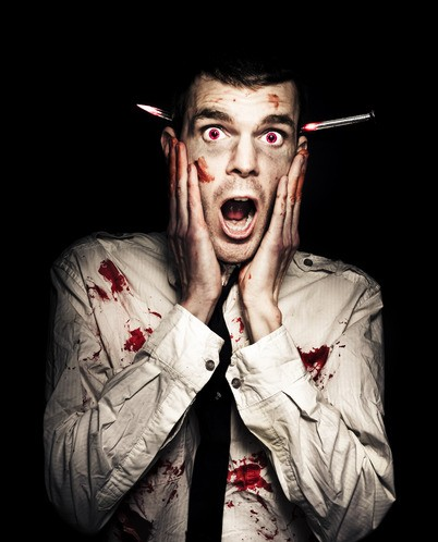 Male Zombie Businessman Displaying Shock Horror