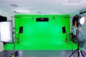 Green Screen video production studio with lights set ready for filming