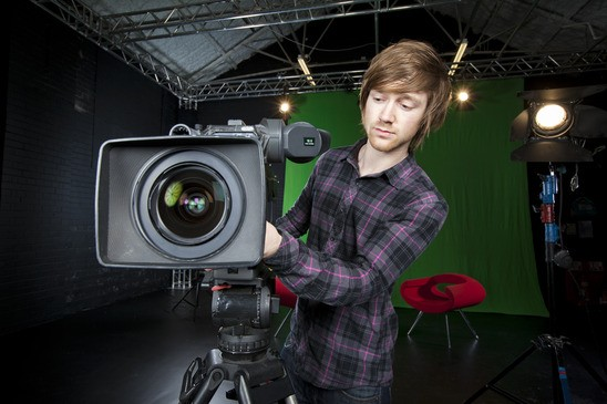 Man preparing a TV Studio Camera