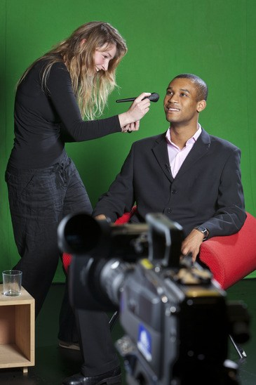 Television presenter and make-up artist on TV set